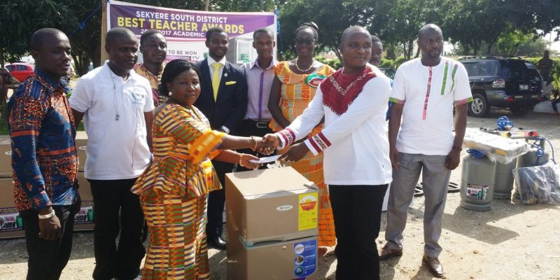 Hon. Catherine Reckling presenting award to Best SHS teacher in Sekyere South District